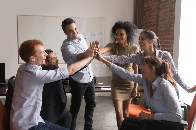 image-858874-happy-diverse-office-employees-group-give-high-five-corporate-trust-concept-happy-motivated-diverse-office-employees-group-give-140990305-c20ad.jpg